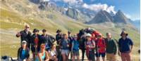 Group posing at the Italian-French border in the Alps |  <i>Ryan Graham</i>