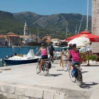 Children cycling into the town of Jelsa on the island of Hvar   Ross Baker