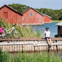 Cyclist taking a break while cycling between islands in Finland