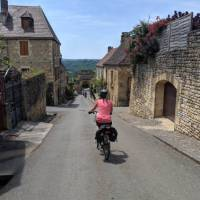 Cycling in the village of Domme   Rob Mills