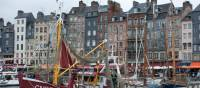 The harbour of Honfleur with its narrow houses and array of boats | Kate Baker