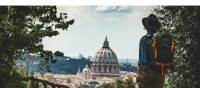 Pilgrim walking into St Peters in Rome at the end of the Via Francigena | Tim Charody