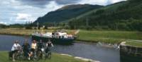 Cyclists at Laggan Loch in the Scottish Highlands