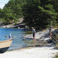 Locals relaxing on the waters edge | Kathy Kostos