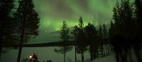 Sky lit up with the northern lights in Swedish Lapland | Ross Baker