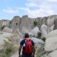 A walker in Cappadocia, walking through the rock formations | Erin Williams