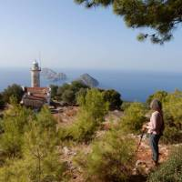 Hiker enjoying the view of Cape Gelidonia lighthouse and the 'Five Islands' | Lilly Donkers