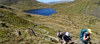 Hikers above Grizedale Tarn in the Lake District | John Millen
