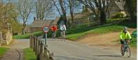 Cycling into Guiting Power |  <i>John Millen</i>