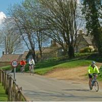 Cycling into Guiting Power   John Millen