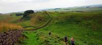 Walking along the Hadrian's Wall trail nearby the wall itself | John Millen