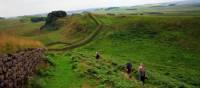 Walking along the Hadrian's Wall trail nearby the wall itself | John Millen