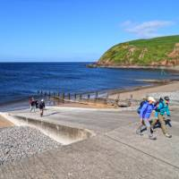 Setting off on the Coast to Coast from St Bees   John Millen