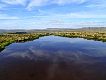 Moorland reflections in a tarn&#160;-&#160;<i>Photo:&#160;John Millen</i>
