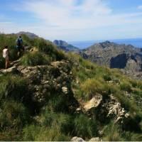 Walkers heading round the coast to Cala Codolar | John Millen